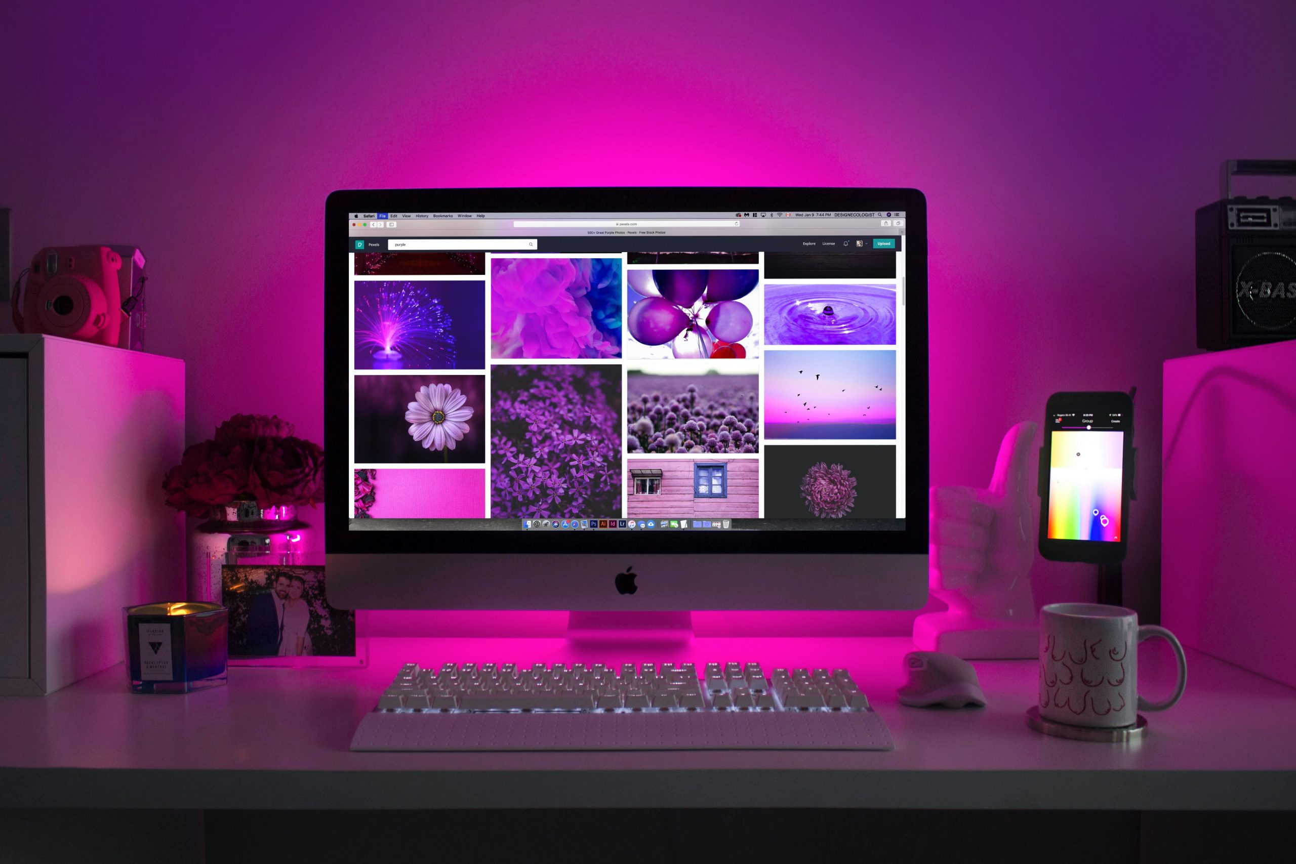 silver iMac on a desk displaying collage photos for beautiful website design